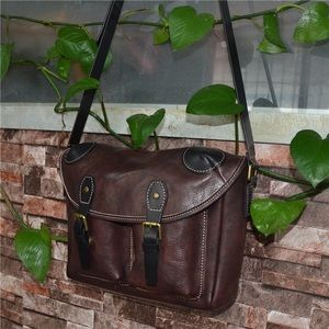 Brown unisex pockets in front crossbody bag
